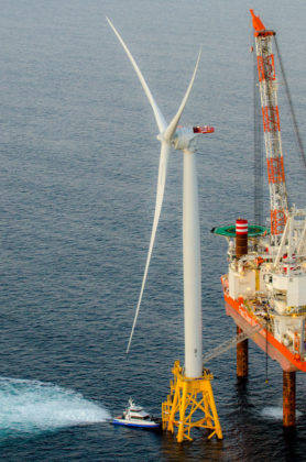STANDING TALL: Deepwater Wind LLC's operations and maintenance crew travels to and from work aboard the Atlantic Pioneer, a vessel built specifically to service the offshore wind industry. / COURTESY DEEPWATER WIND
