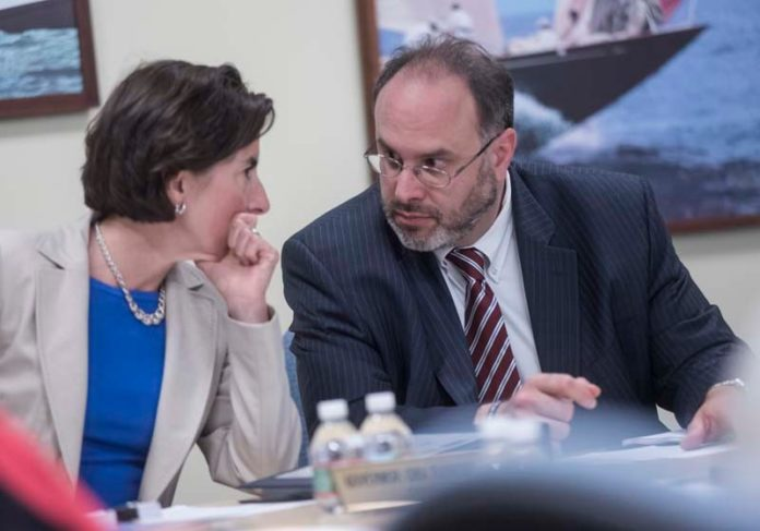 GOV. Gina M. Raimondo and R.I. Commerce Secretary Stefan Pryor are shown at a Commerce RI board meeting. Raimondo and the board approved the awarding of Innovation Vouchers to six local companies.  / PBN FILE PHOTO/MICHAEL SALERNO