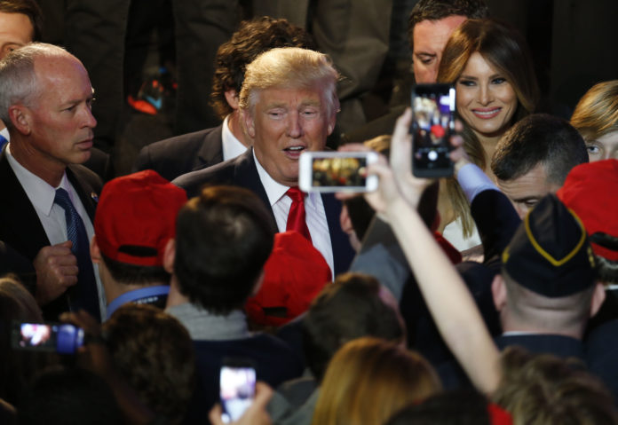 U.S. President-elect Donald Trump, center, greets attendees during an election night party at the Hilton Midtown hotel in New York on Wednesday, Nov. 9. Trump was elected the 45th president of the United States in a repudiation of the political establishment that jolted financial markets and likely will reorder the nation's priorities and fundamentally alter America's relationship with the world. / BLOOMBERG NEWS/ANDREW HARRER