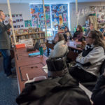 A WHOLE NEW WORLD: Highlander Institute is dedicated to spreading innovation to transform education. Here, left, Eric Butash, director of operations for the nonprofit, discusses smartphone potential with staff at Central Elementary School in Lincoln. / PBN PHOTO/MICHAEL SALERNO