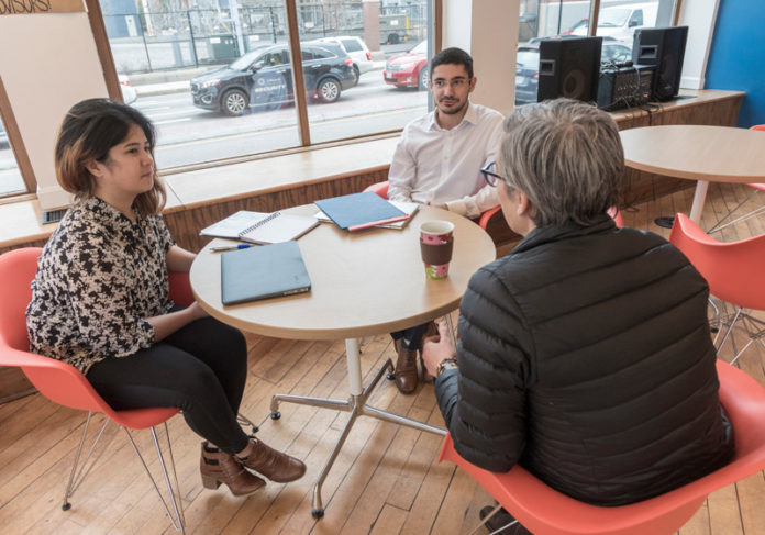 JUMP-START: Francisco Portela, center, founder of Portela Soni Medical LLC, meets with, from left, Paula Cunanan, inclusivity initiative manager for Social Enterprise Greenhouse, and Fran Loosen, Cadre strategist. / PBN PHOTO/MICHAEL SALERNO