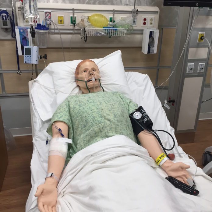 "THIS 3G ADULT simulator serves as a ""patient"" for CCRI allied health students in a fully-stocked simulated hospital room. / PBN PHOTO/NANCY KIRSCH"