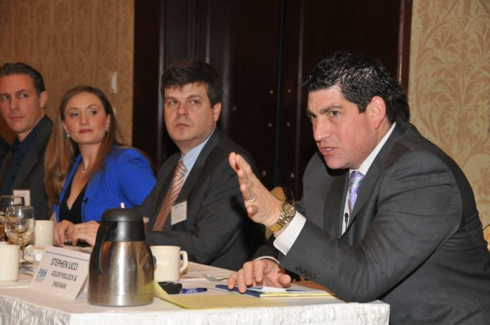 PANELISTS ARE shown at the Cybersecurity Summit hosted by Providence Business News at the Crowne Plaza Providence-Warwick on Thursday. From left to right, Peter Nelson, co-founder of NetCenergy LLC; Francesca Spidalieri, senior fellow for cyber leadership at the Pell Center at Salve Regina University; Timothy J. Edgar, academic director, executive master in cybersecurity & fellow, Watson Institute for International & Public Affairs at Brown University; and Stephen Ucci,  counsel from Adler Pollock & Sheehan P.C. and a member of the R.I. House of Representatives.  / PBN PHOTO/MIKE SKORSKI