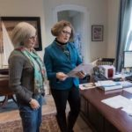 SERIOUS BUSINESS: Morgan Grefe, right, executive director of the R.I. Historical Society, meets with Mary Lou Upham, membership officer. / PBN PHOTO/ MICHAEL SALERNO