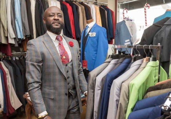 SELF-MADE MAN: Frank Ankoma opened Copa Menswear seven years ago. He thinks the city can do more to help immigrant business owners. / PBN PHOTO/MICHAEL SALERNO