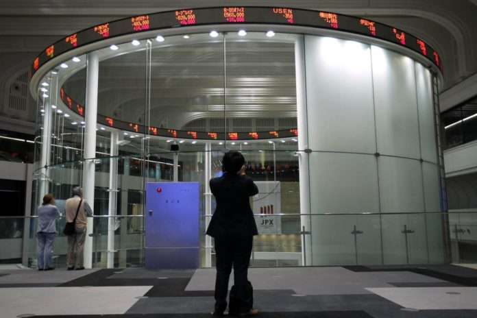 THE DOW Jones Industrial Average climbed past 20,000 for the first time as stocks around the world extended a rally after corporate earnings reignited investors' optimism in economic growth. / BLOOMBERG NEWS PHOTO