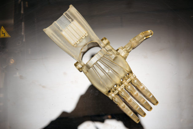 A SAMPLE of the 3D prosthetic hand that was produced on New England Institute of Technology's 3D printer.  Each hand takes nearly 19 hours to print and 1 ½ hours to clean. / COURTESY TREVOR HOLDEN PHOTOGRAPHY