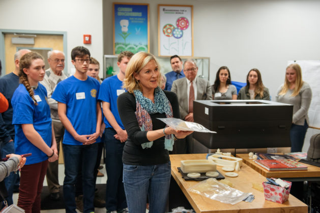 NEW ENGLAND Institute of Technology Mechanical Engineering instructor Andrea Unger explains the 3D prosthetic hand printing process to Rocky Hill Students and members of the East Greenwich Rotary Club. / COURTESY TREVOR HOLDEN PHOTOGRAPHY