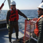 KEEPING WATCH: INSPIRE Environmental team members Jimmy Flynn, left, a marine scientist, and Ben Taylor, a geographic information system analyst, visit the Block Island Wind Farm in March 2016, prior to the installation of blades and the wind generator. / COURTESY INSPIRE ENVIRONMENTAL/STEVE SABO