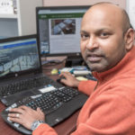 TECH TANDEM: A $29,000 Innovation Voucher was won by Newport-based PowerDocks LLC and Roger Williams University to help build renewable-energy marine charging stations. Charles Thangaraj, RWU assistant professor of engineering, will head research for  the project. / PBN PHOTO/ MICHAEL SALERNO