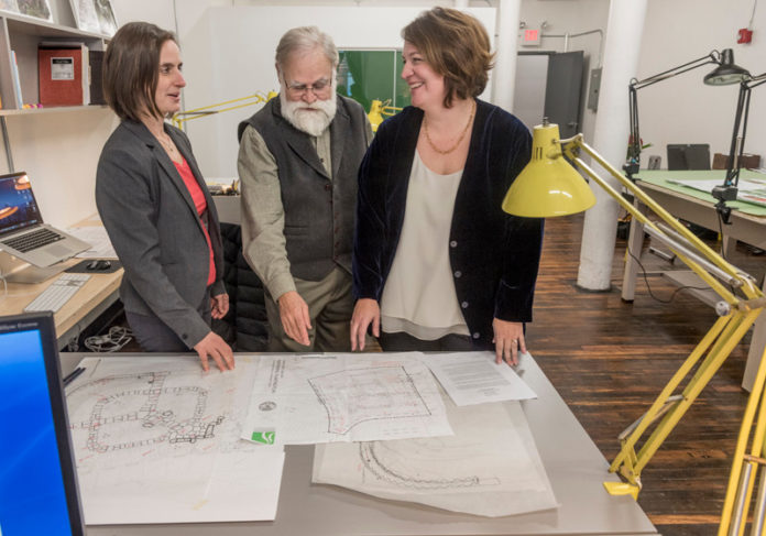 NEW SPACE: Landscape architecture firm Searle Design Group has moved into newly renovated space at the Hope Artiste Village in Pawtucket. From left, owners Melissa Bagga, associate principal; Colgate Searle Jr., principal; and Taber Jossi  Caton, principal, go over project plans. / PBN PHOTO/MICHAEL SALERNO