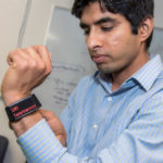 KUNAL MANKODIYA, ASSISTANT professor in the College of Engineering at the University of Rhode Island, is shown wearing the watch developed at URI to monitor Parkinson's patients. Mankodiya received a $525,000 CAREER grant from the National Science Foundation that will allow him over five years to continue researching and creating smart clothing. / PBN FILE PHOTO/ MICHAEL SALERNO