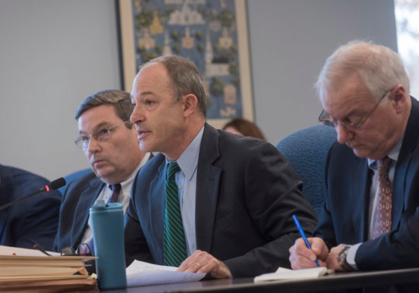 ENERGY ADVOCATES: Invenergy representatives, from left, Richard Beretta, Alan Shoer and John Niland, business-development director, answer questions during a R.I. Energy Facility Siting Board meeting. / PBN PHOTO/MICHAEL SALERNO