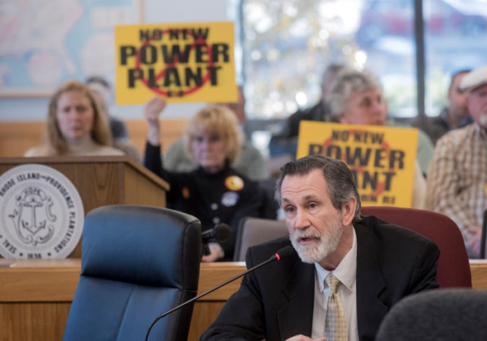 BURRILLVILLE attorney Michael McElroy speaking to the R.I. Energy Facility Siting Board in February with a group opposing the proposed power plant in the background. PBN FILE PHOTO/MICHAEL SALERNO