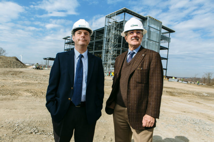 ADDED SERVICES: University Orthopedics is building a new facility in East Providence to expand services. CEO Weber Shill, left, visits the site with Michael Integlia, president and CEO of Michael Integlia & Co., construction manager for the project. / PBN PHOTO/RUPERT WHITELEY