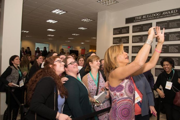 EAGER FANS: Hoda Kotb of NBC News, the luncheon speaker at the 2015 Women's Summit, pauses to take a selfie with people who signed up for her book signing, before leaving campus. / COURTESY PAM MURRAY