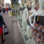 INCREASED CONSUMER SPENDING pushed the final fourth-quarter GDP estimate higher, to an annualized 2.1 percent growth rate, in Commerce Department data released Thursday. / BLOOMBERG NEWS PHOTO