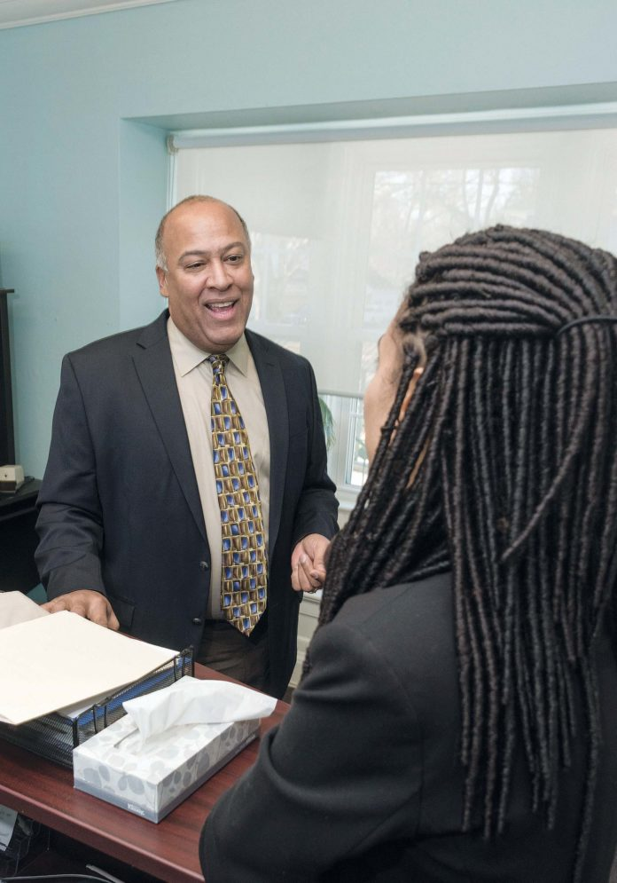 CHANGING PERSPECTIVES: Gerry Fernandez, left, founder of the Providence-based Multicultural Foodservice & Hospitality Alliance, speaks with M. Anyi Espinal, member-relations manager. / PBN PHOTO/MICHAEL SALERNO