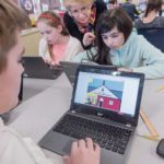 NEW SKILLS: Bernadette Durkin is using the skills she learned during the October 2016 Rhode Island College and General Assembly computer science boot camp to help her fifth-grade class at Cumberland Hill School in Cumberland learn to code. From left, Luke Plumer, 11, foreground; Leah Mandeville, 11; Durkin; and Adriana Panagoulopoulos, 10. / PBN PHOTO/MICHAEL SALERNO