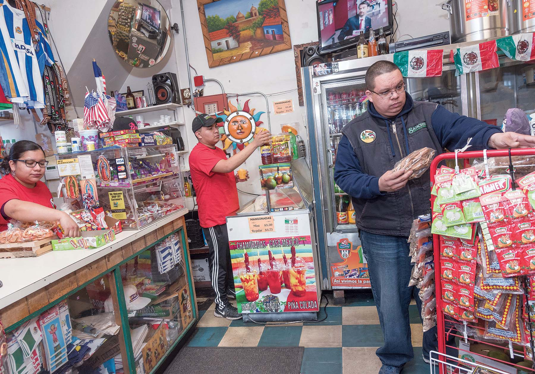 FAMILY AFFAIR: Casa Mexico, a family-owned retail store located on Atwells Avenue in Providence, specializes in Mexican grocery items, tacos, desserts and other items. From left: co-owner Jackie Sanchez, nephew Enrique Sanchez Jr., and Ivan Sanchez, co-owner. / PBN PHOTO/MICHAEL SALERNO