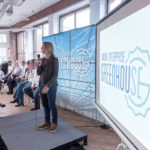 SOCIAL ENTERPRISE GREENHOUSE CEO Kelly Ramirez addresses the crowd during SEG's impact-accelerator graduation and pitch event at the Davol Square offices in Providence. / PBN FILE PHOTO/MICHAEL SALERNO