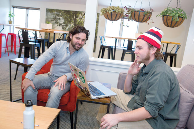 Spire Space co-owner Josh Furtado chats with Chris Jones of Tower Hill Associates, which shares the building with Spire. / PBN PHOTO/KATE WHITNEY LUCEY