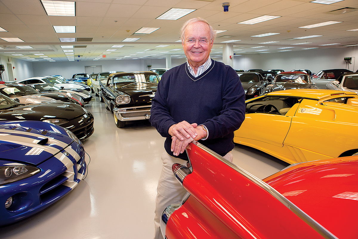 IMPRESSIVE COLLECTION: ­Gunther Buerman, who is set to open the Newport Car Museum this summer, stands among his personal collection of classic cars.