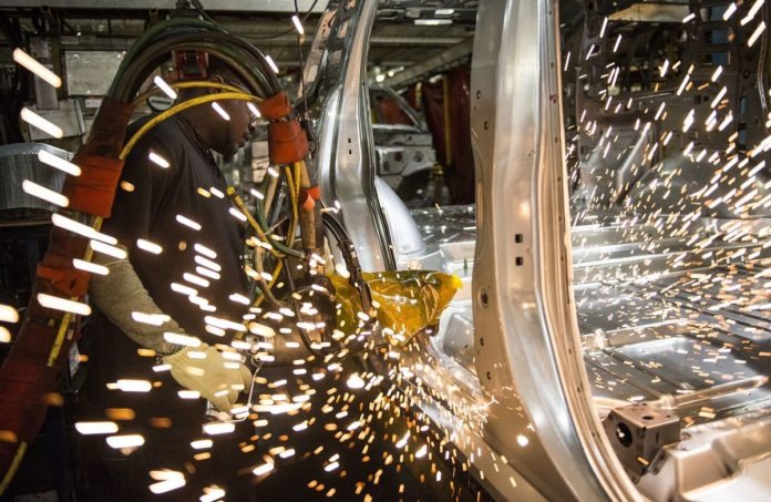An employee welds together a frame for a sports utility vehicle (SUV) during production at the General Motors Co. (GM) assembly plant in Arlington, Texas, U.S., on Thursday, March 10, 2016. The U.S. Census Bureau is scheduled to release business inventories figures on March 15. /BLOOMBERG PHOTO VIA GETTY IMAGES/ MATTHEW BUSCH/