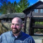 PITCHING CAMP: Marc Cardin, director of support services and CFO for the Boy Scouts Narragansett Council, helps out where needed when important tasks are at hand, especially at Camp Yawgoog in Hopkinton. / PBN PHOTO/MICHAEL SALERNO