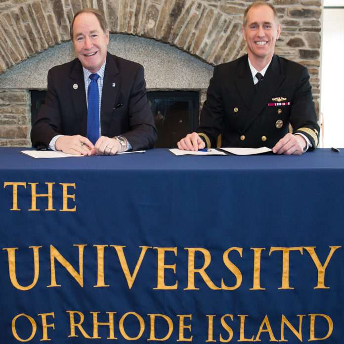 UNIVERSITY OF RHODE Island President David M. Dooley, left and Capt. Michael R. Coughlin, commanding officer at the Newport Naval Undersea Warfare Center, are shown after signing the partnership agreement. /COURTESY URI/JESSICA VESCERA
