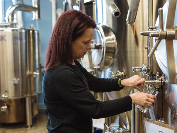 ORIGINAL RECIPE: Owner Tracey Cinelli prepares a fresh beverage in her Skyroc Brewery facility in Attleboro. / PBN PHOTO/RUPERT WHITELEY