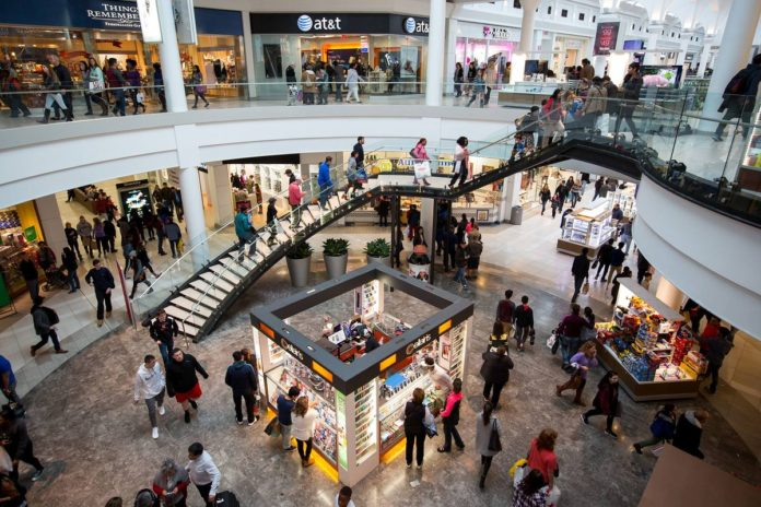 SHOPPERS WALK through the Menlo Park Mall in Edison, N.J. Household sentiment was little changed in April from the previous month, holding at an elevated level on optimism about personal finances, University of Michigan survey data showed. /BLOOMBERG NEWS PHOTO/ MICHAEL NAGLE
