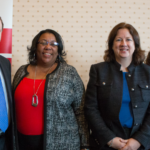 DITRA EDWARDS and Donna Childs are flanked by the Rhode Island Foundation's Neil D. Steinberg and Jessica David, far right. Childs and Edwards were chosen from nearly 200 applicants to receive $300,000 over three years to pursue their proposals for improving civic engagement in Rhode Island. / COURTESY RHODE ISLAND FOUNDATION