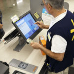 An employee counts U.S. dollar banknotes while completing a purchase at a Wal-Mart Stores Inc. location in Burbank, California, U.S., on Tuesday, Nov. 22, 2016. Consumer hardline retailers are hopeful Black Friday will provide a strong start to the holiday shopping season, but any lift may come at the expense of margins, as the landscape has become increasingly promotional. /COURTESY BLOOMBERG VIA GETTY IMAGES / PATRICK T. FALLON