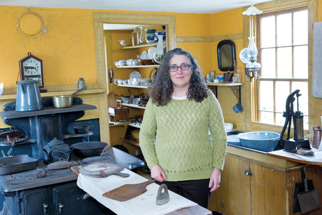 "VICTORIAN ERA: Little Compton Historical Society Managing Director Marjory O'Toole stands in the Victorian-period kitchen at The Wilbor House Museum in Little Compton. O'Toole said collaboration among the state's nearly 200 preservation groups would be difficult without ""some real mission-changing."" / PBN PHOTO/KATE WHITNEY LUCEY"
