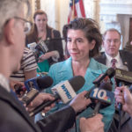 DEALS WORTH MAKING: Gov. Gina M. Raimondo and Jeffrey S. Bornstein, right, senior vice president and chief financial officer for General Electric Co., faced the media following the announcement of GE Digital's plans to bring 100 jobs to Providence.  / PBN FILE PHOTO/ MICHAEL SALERNO