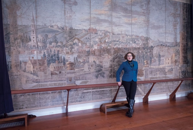 CHALLENGED: C. Morgan Grefe, executive director of the Rhode Island Historical Society, with the Providence Theatre Curtain, circa 1806-1811, in the background. Grefe says the greatest challenge to collaboration among the state's preservation organizations is lack of time and difficulty identifying material that suits both audiences. / PBN FILE PHOTO/MICHAEL SALERNO
