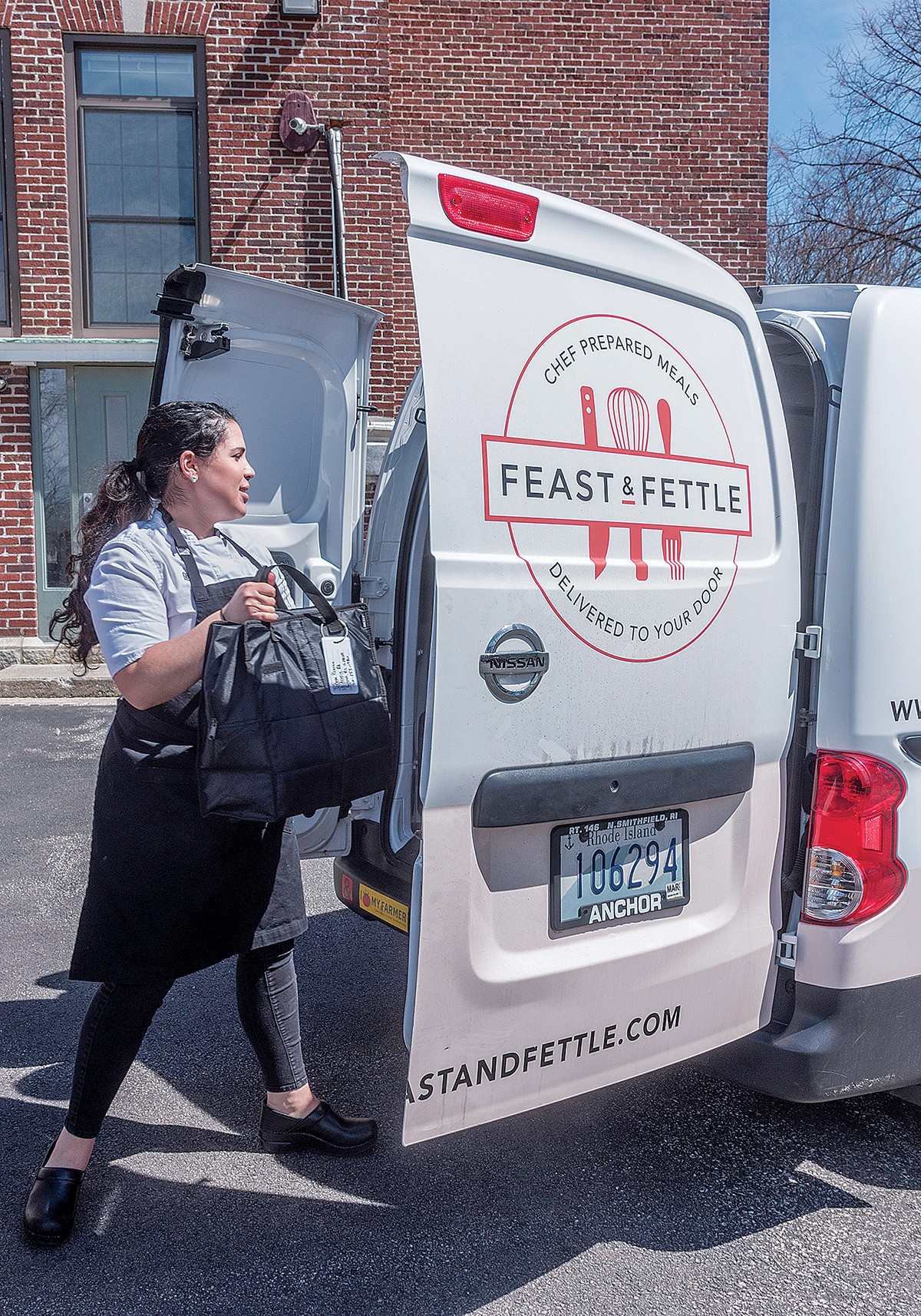 READY TO EAT: Maggie R. Mulvena, owner of meal-delivery service Feast & Fettle, brings an order for a Lincoln family to the company van. / PBN PHOTO/MICHAEL SALERNO