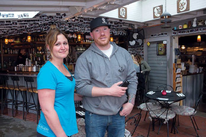 KEEPING TABS: Scott and Adrienne Kirmil own Diego's Mexican Restaurant on Bowen's Wharf in Newport. After he discovered a former employee had copied a key and was coming into the establishment at night, Scott decided to invest in Cox ­Business Security Solutions to keep tabs on their growing business. / PBN PHOTO/KATE WHITNEY LUCEY