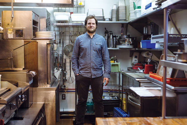 "FILLING A VOID: Benjamin Sukle, pictured in his kitchen at Oberlin, says he decided to open the restaurant, his second, because he wanted a place where people could get ""some slices of fish, a pasta and some really good wine,"" adding, ""that's a void I think needed to be filled."" / PBN PHOTO/RUPERT WHITELEY"
