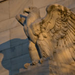 AN EAGLE sculpture stands on the facade of the Marriner S. Eccles Federal Reserve building in Washington, D.C./ BLOOMBERG NEWS PHOTO/ ANDREW HARRER
