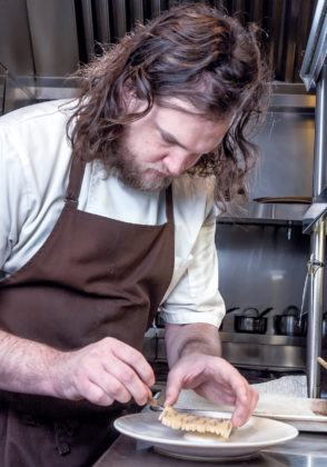 "LOCAL FOCUS: Benjamin Sukle, owner and chef of Providence-based restaurants Oberlin and birch, plates one of his dishes. Sukle says birch focuses on getting ingredients from Rhode Island and New England, especially in the winter months, whereas Oberlin ""is a celebration of using everything in bulk,"" including a farmer's excess produce.