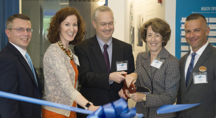 FROM LEFT, Corey McCarty, vice president, consumer segment, Blue Cross & Blue Shield of Rhode Island; Melissa Cummings, senior vice president and chief customer officer, BCBSRI; East Providence Mayor James Briden; Kim Keck, BCBSRI president and CEO; and Paul Ryan, BCBSRI director of retail strategy and operations, at the ribbon-cutting for BCBSRI's new Your Blue Store in East Providence. /COURTESY BLUE CROSS & BLUE SHIELD OF RHODE ISLAND
