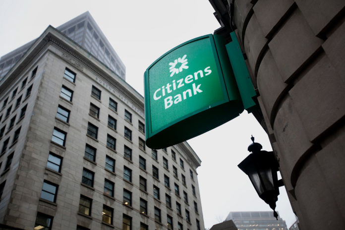 CITIZENS BANK is a wholly owned subsidiary of Providence-based Citizens Financial Group Inc. The bank posted net income of $1.7 billion in 2017, a 58.1 percent increase on its 2016 performance. / BLOOMBERG FILE PHOTO/KELVIN MA