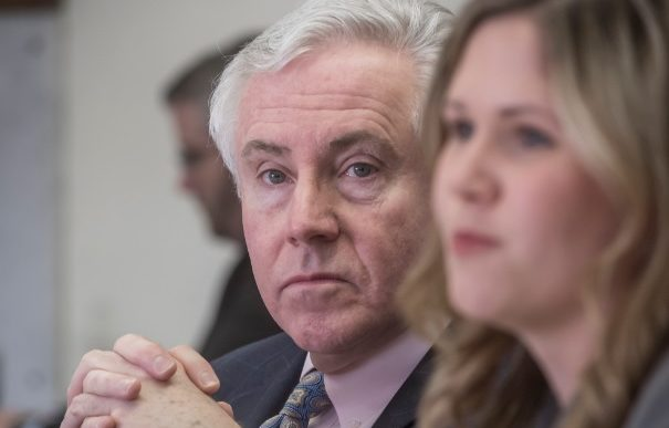 R.I. AUDITOR GENERAL Dennis E. Hoyle, left, released a report Thursday that found the state has paid $402.3 million for a new unified computer system that determines eligibility for social services and established the statewide health care exchange. /PBN FILE PHOTO/MICHAEL SALERNO