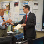 R.I. GENERAL TREASURER Seth Magaziner, right, has named Richard Garland, of North Kingstown High School, the Rhode Island Financial Literacy Educator of the Year. /COURTESY TWITTER/@SethMagaziner