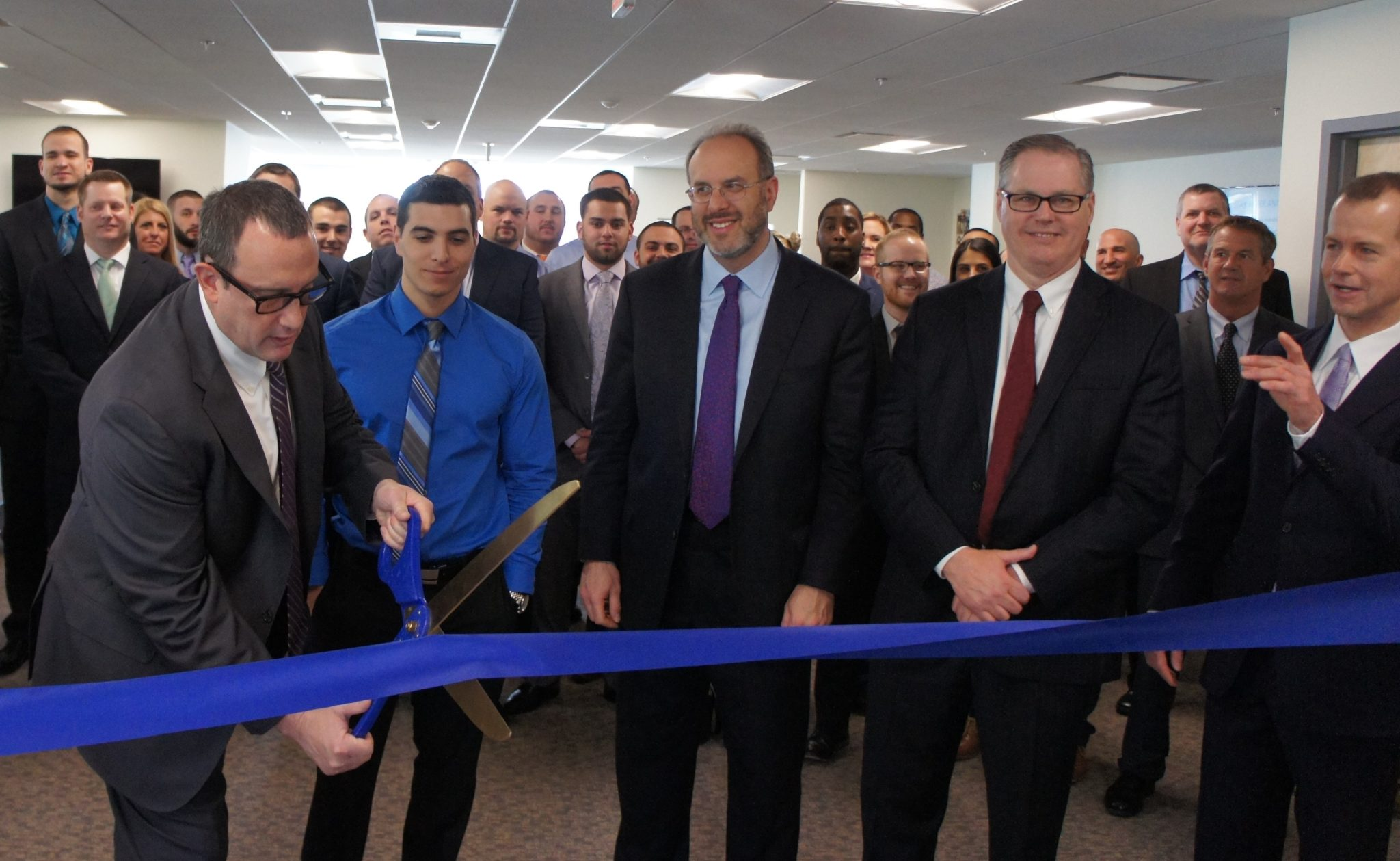 Granite Telecommunications moved to larger office and announced Wednesday. It plans to hire at least 50 new employees for the new Lincoln office. Pictured (from left to right): Paul Goodwin, R.I. General Assembly Senator Thomas J. Paolino, R.I. Secretary of Commerce Stephen Pryor, Lincoln town administrator T. Joseph Almond, and Rand Currier/ COURTESY GRANITE