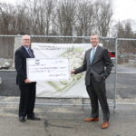 WASHINGTON TRUST CHAIRMAN and CEO Joseph MarcAurele, left. and President and COO Edward Handy, right, stand in front of the site of the Station Memorial Park in West Warwick, RI in March 2017. The completed park is due to open at a dedication ceremony on Sunday, May 21st. /COURTESY WASHINGTON TRUST