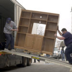 Moving company employees remove furniture from a business in Chicago, Illinois. COURTESY BLOOMBERG/ TANNEN MAURY