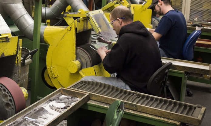 Employees polish pocket knives at the W.R. Case & Sons Cutlery Co. manufacturing facility in Bradford, Pennsylvania, U.S., on Wednesday. The U.S. Census Bureau is scheduled to release factory orders figures on April 4. / BLOOMBERG / TY WRIGHT